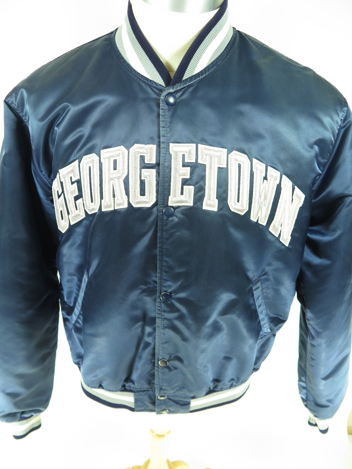 0313c000e23515 Vintage 80s Starter Georgetown University satin jacket. Find more men s and  women s authentic vintage clothing at The Clothing Vault.