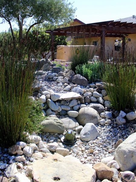 Using pebbles and rocks you can create a dry river bed that