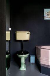 Photo of Bunte Vintage Badezimmerarmaturen knallen gegen dunkle Wände. – Dekoration Styles,  #Badezimm…