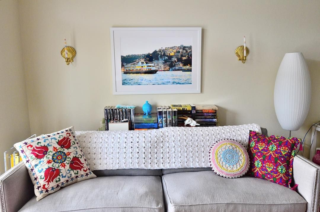Cozy little couch vignette with our Irvine Slim frame. #framebridge
