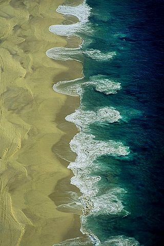 Aerial photo of rip currents of the Beach at Cabo San Lucas, Baja California Sur, Mexico.