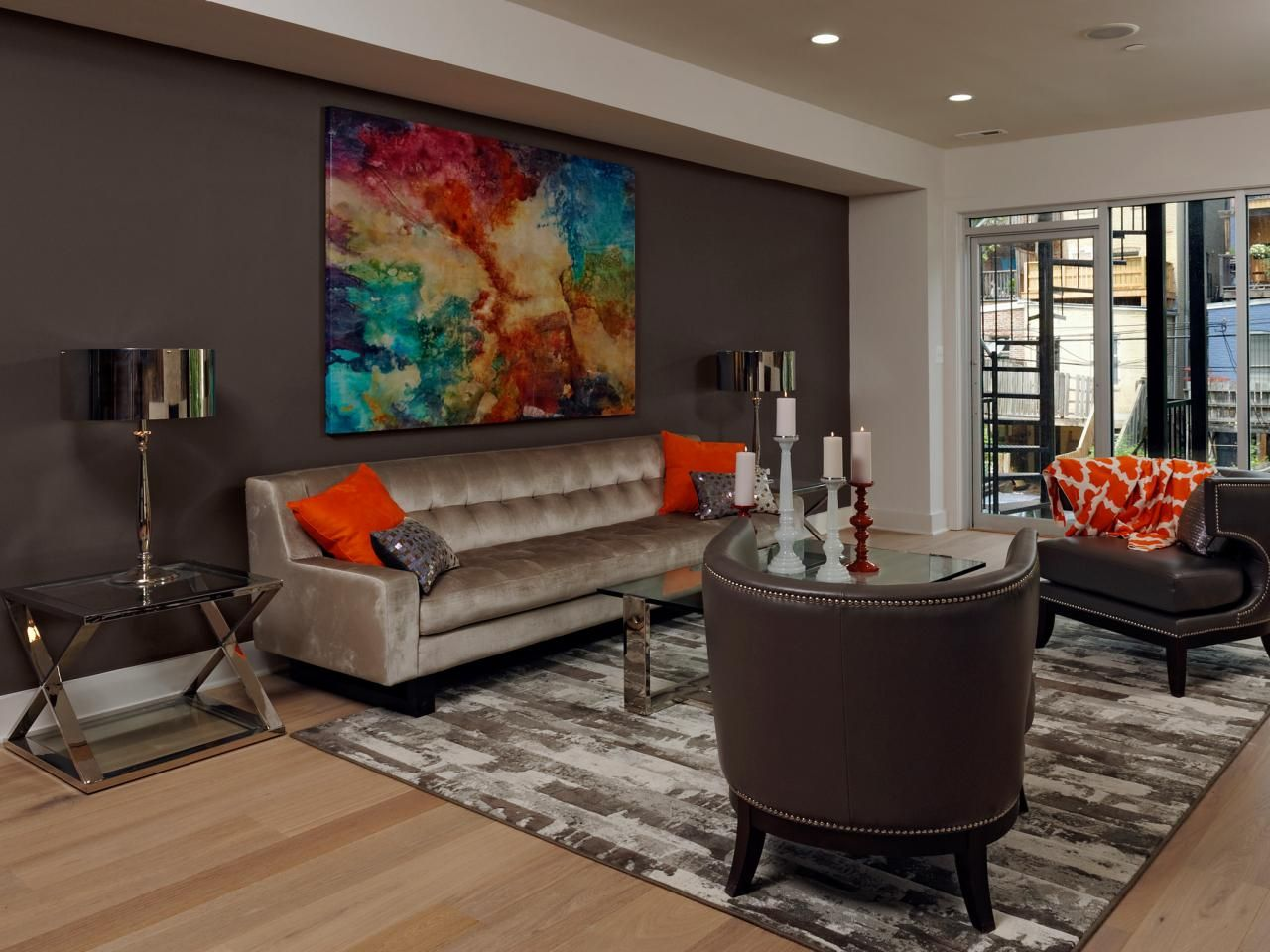 a deep brown accent wall serves as a backdrop for this contemporary