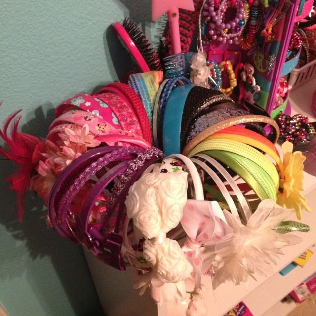 Storage and display for the girls head bands!! I just used a short and wide vase!! I also put them in rainbow order to make it easy to find the color we need!:-)