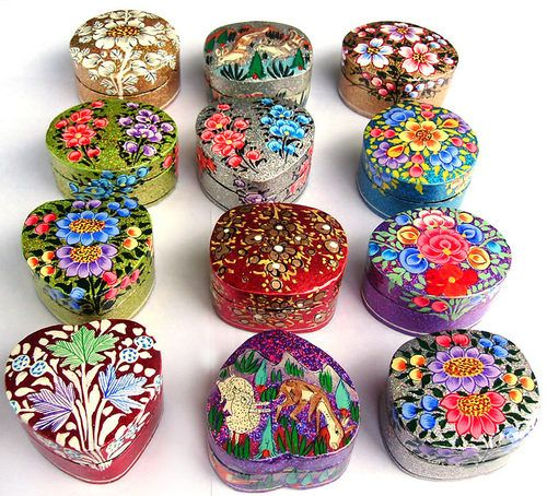Wrap different objects with cool shapes in foil, paper mache, then cut off to make boxes. A strip of cardboard inside the rim of the bottom half helps to keep the lid on.