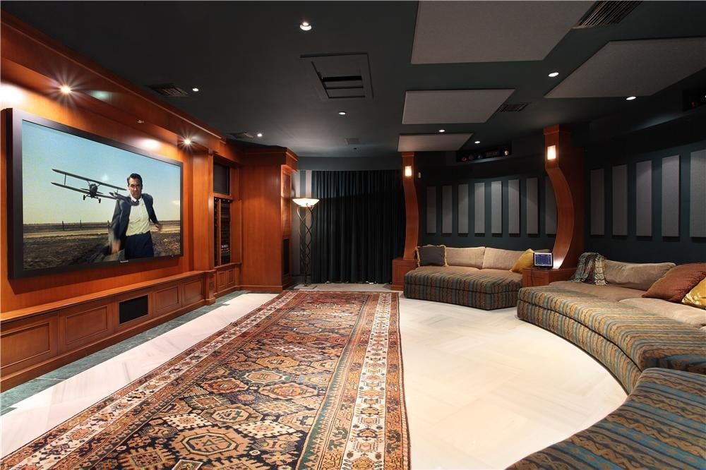 Modern Home Theater With Acoustic Panel Wood Paneling Can Lights Area Rug Wall Sconce Built In Bookshelf Media Room