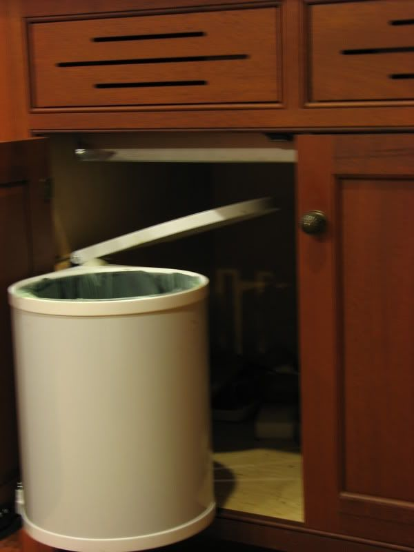 Nice Our [compost Bucket] Is Attached To The Cabinet Door Under The Sink. The Lid  Lifts Up When The Door Is Opened.