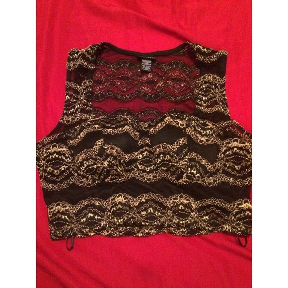 Gold and black crop top. Size Xl. Fits up to a C bust. Not stretchy. Rue 21 Tops Crop Tops