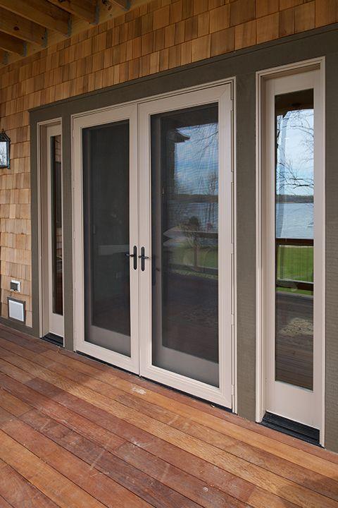 clad swinging patio doors by windows