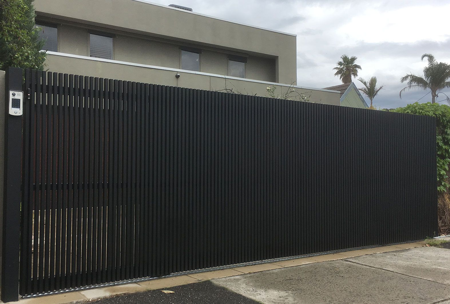 Steel Sliding Gate With Battens Overhang Powdercoated Mannex Black Sliding Gate Electric Sliding Gates Outdoor Gate