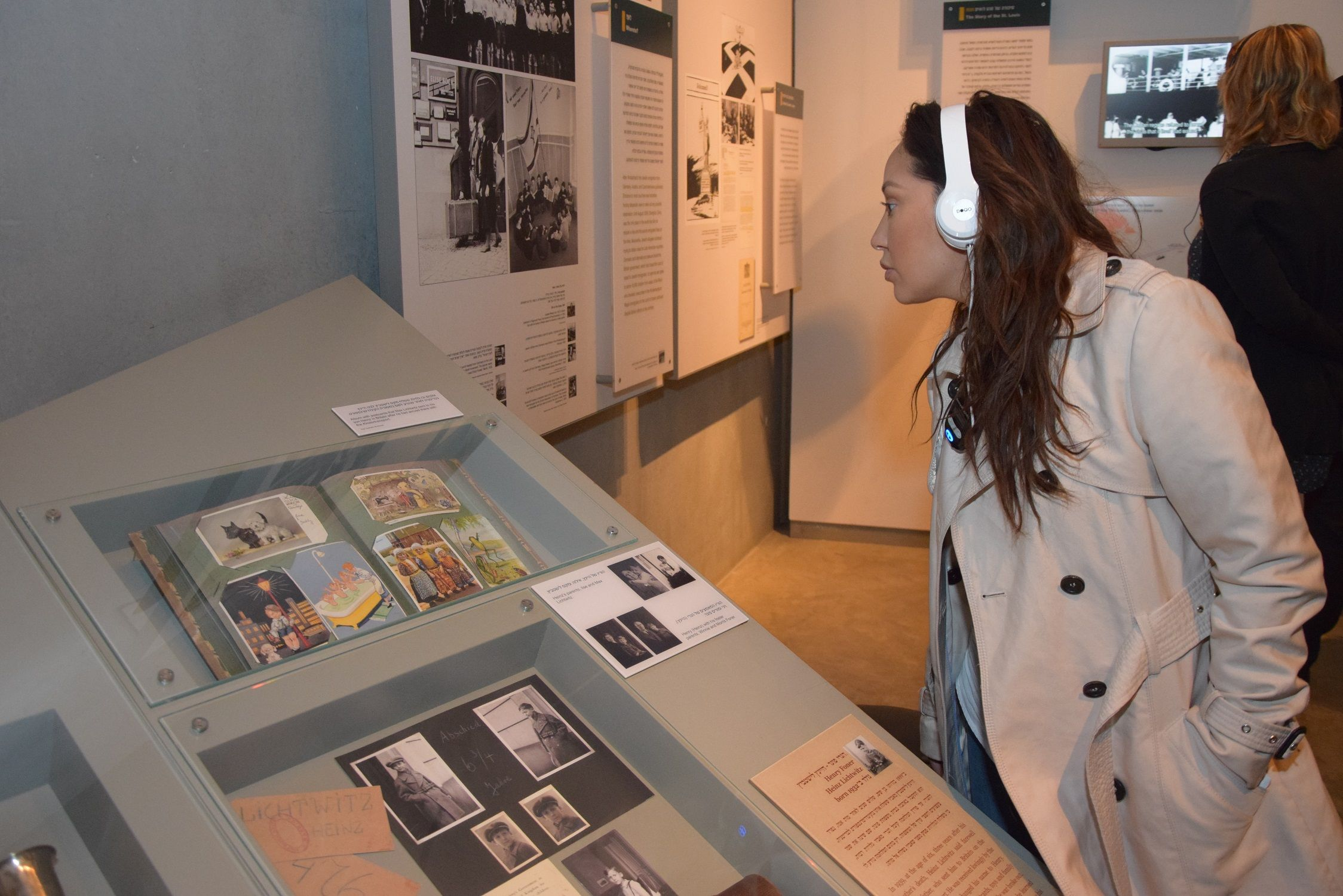 Singer and songwriter Adrienne Bailon explores an exhibit about the Kindertransport during a recent visit to Yad Vashem