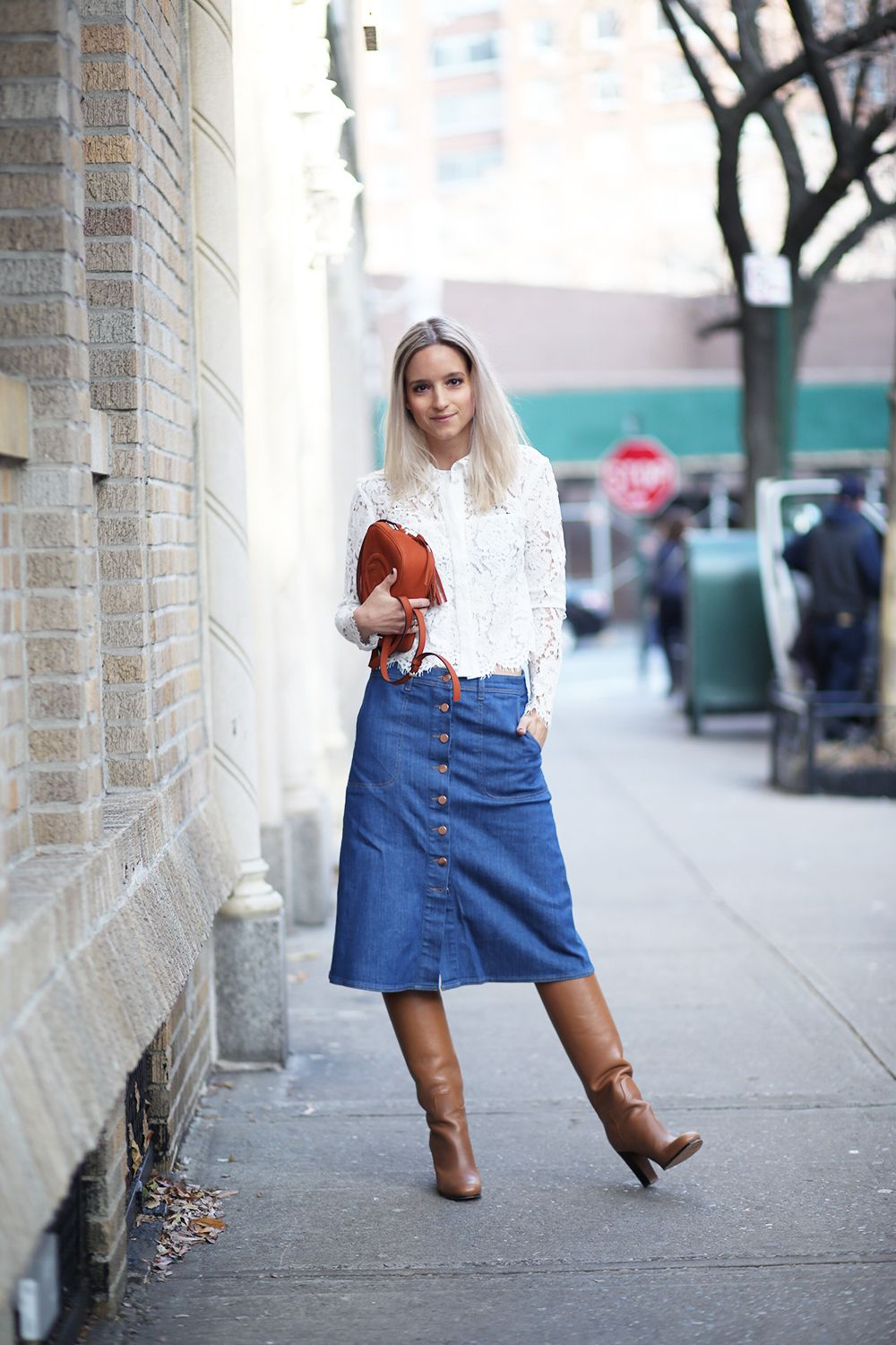 A denim midi skirt and knee-high boots are transitional weather ...