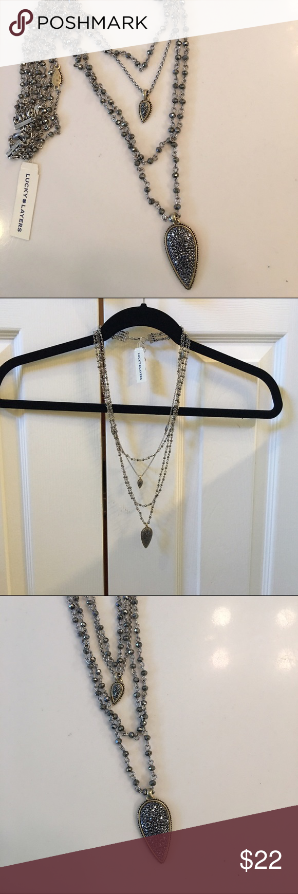 Lucky brand triple necklace new with tags Triple necklace with smoky rhinestones and a variety of shapes and textures. Lucky Brand Jewelry Necklaces