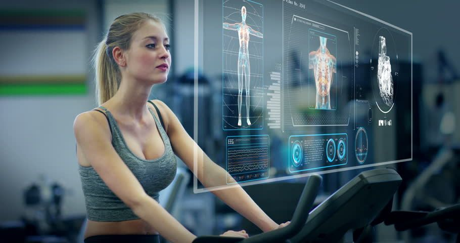 Ad: Futuristic portrait of a beautiful girl in the gym on a stationary bike uses a hologram to strengthen her body and heart heartbeat and pressure Concept future of humanity,new technology futuristic gym | Shutterstock Footage | Keywords: 3d, adult, augmented, background, bike, body, computer, concept, device, digital, display, dumbbells, exercise, female, fitness, future, futuristic, gadget, glasses, graphic, health, healthy, hologram, home, illustration, innovation, interface, isometric, life #dumbbellexercises