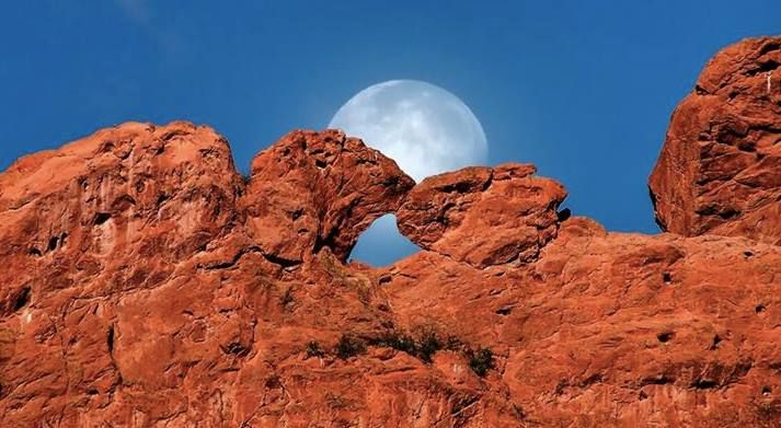 Moon Behind Kissing Camels At The Garden Of The Gods In
