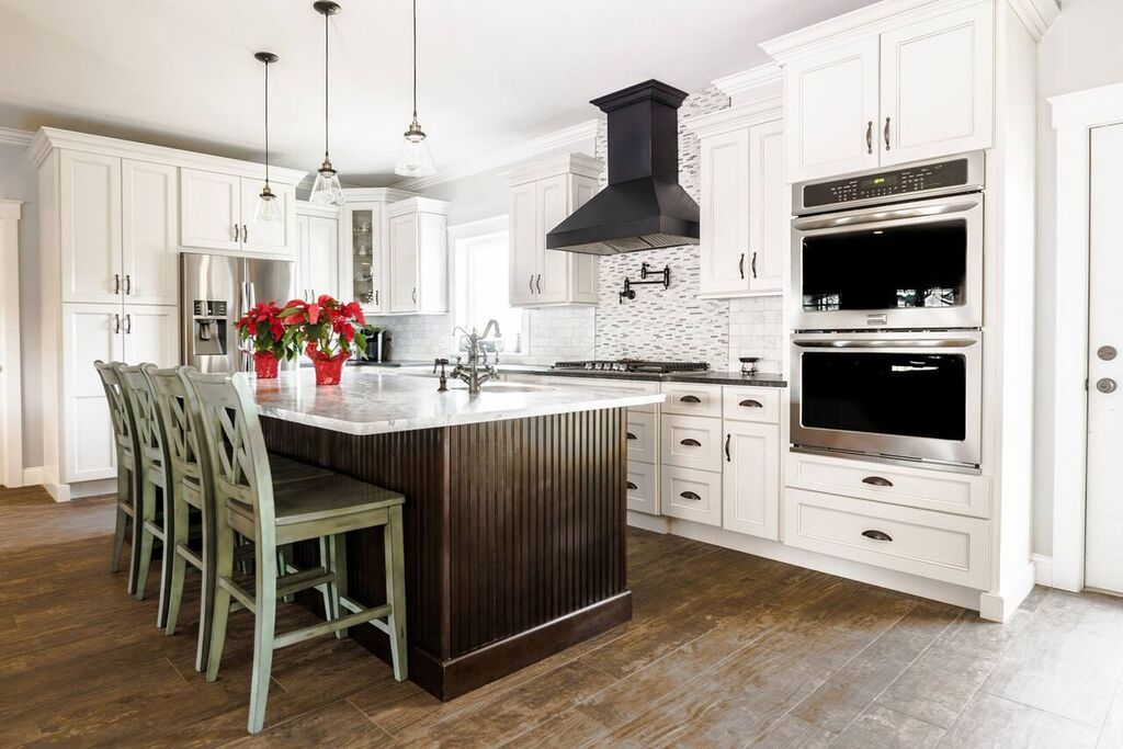 Traditional White Cabinets With Black Overhead Range Hood And Rustic Wooden Floors Wholesale Kitchen Cabinets Kitchen Cabinet Manufacturers Kitchen Cabinets