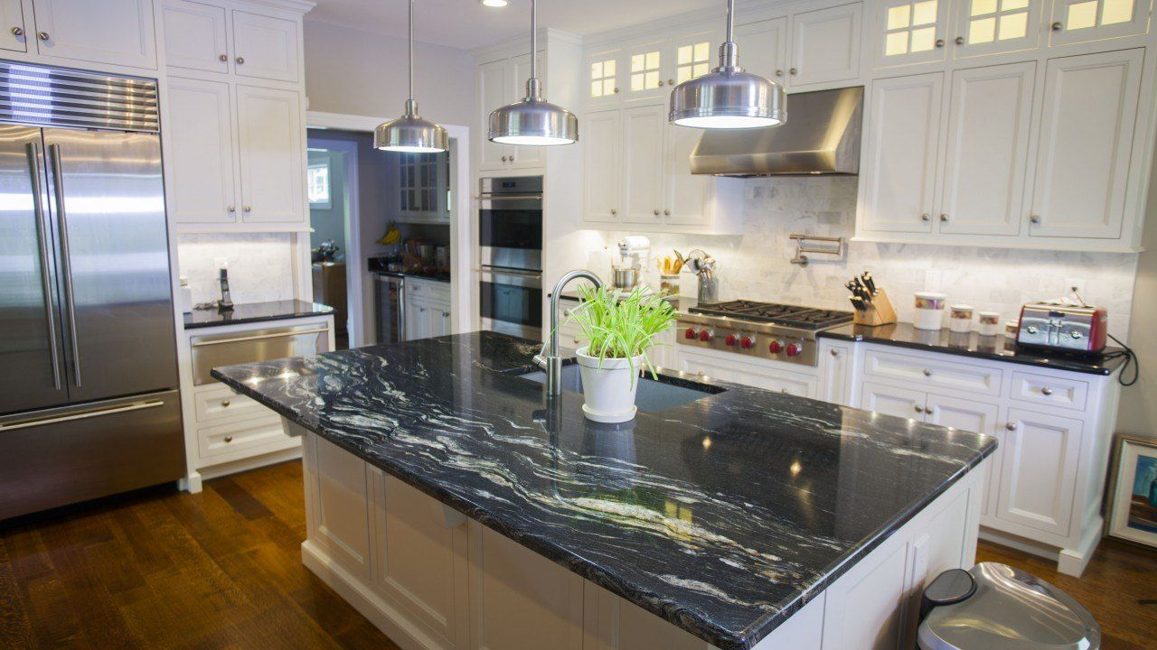 This Open Kitchen Features Two Different Granites That Are Very Similar In Colors But Black Granite Countertops Black Granite Kitchen Dark Granite Countertops