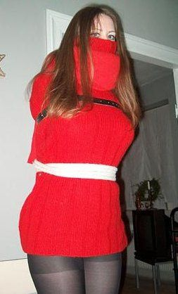 Marianne bound in red sweater & gagged with another red ...