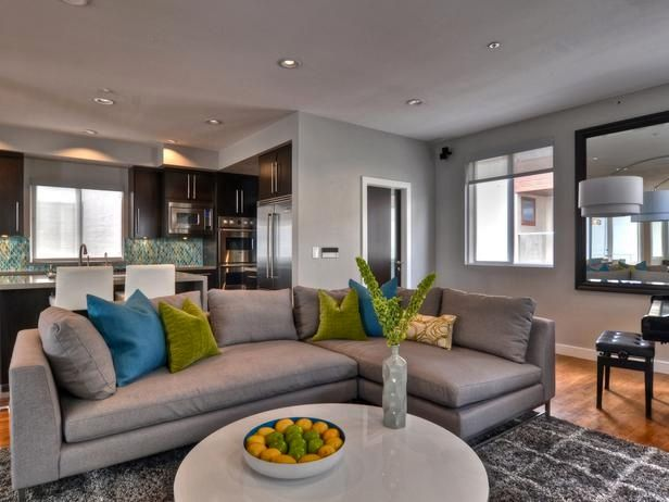 Nice idea for HGTV grey living room add blue and yellow cushion and