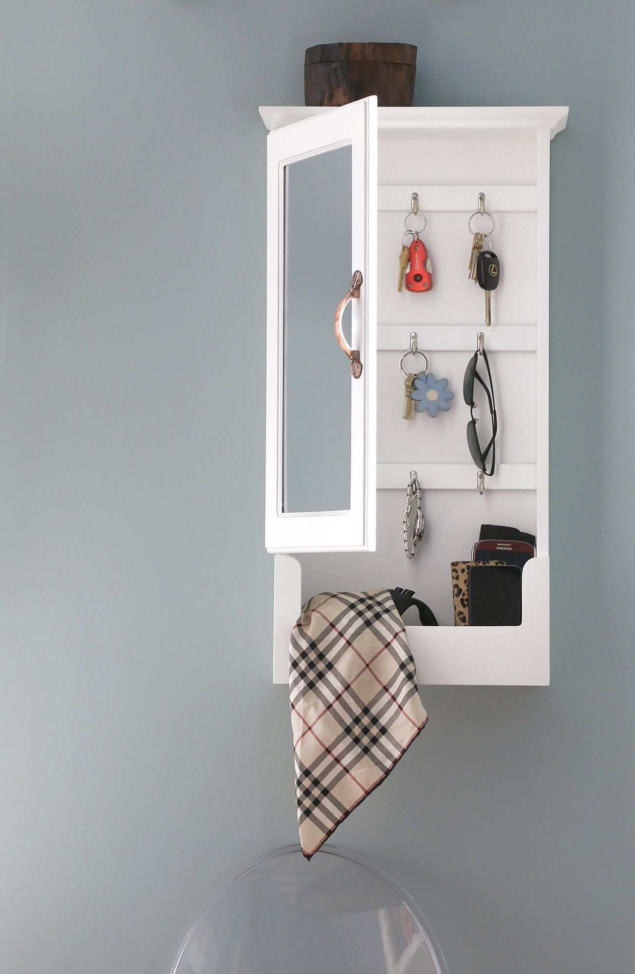 "Features:  -The perfect spot to store and organize your keys.  -Hooks for necklaces and bracelets. Dimensions:  -0.12"" Flat mirror.  --Who says storage has to be stylistically barren. The Wessex Key C"