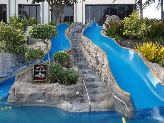 Pool slides google search pool ideas water slides - Swimming pools with waterslides in london ...