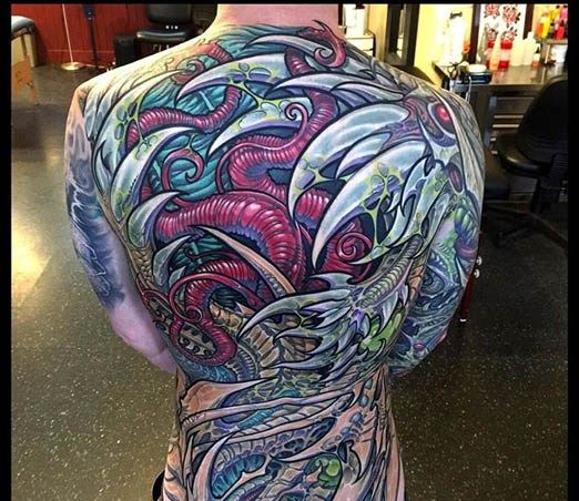 7d8daf3142cd9 Colorful piece by Ron Earhart. #inked #Inkedmag #tattoo #colorful #back # Piece #biomech #organic