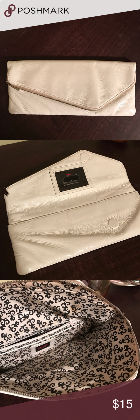 Soft patent leather clutch by Hobo International Gorgeous Hobo International clutch bag. Soft and buttery. Top zip closure and magnetic closure. Two inside pockets and outside pocket under flap. Small stain on the lining inside.  10 inches wide. HOBO Bags Clutches & Wristlets