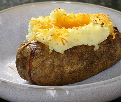 These baked stuffed potatoes make a tasty side to grilled or broiled steaks, pork, or chicken. Top these potatoes with shredded Cheddar, Parmesan, or your favorite blend of cheeses. Garnish the cheese-topped potatoes with diced cooked bacon, green onions, or snipped chives or parsley.