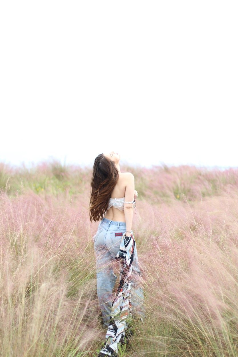 Girl model in pink fields in tampa florida photography