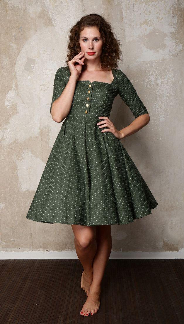 Dunkelgrünes, klassisches Petticoat-Kleid mit weißen Punkten ...