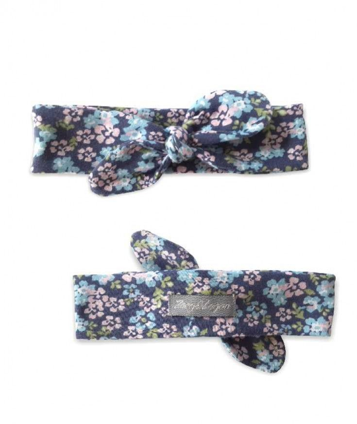 """The Summer Floral Knotted Headband is handmade with a soft fabric that stretches comfortably around your babies head and looks absolutely gorgeous on all baby girls. Zoey & Logan headbands can be used for all occasions from weddings, to parties or play dates. *0-6 months (14"""" not stretched to..."""