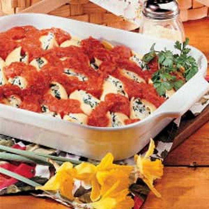 Stuffed Pasta Shells Recipe Main Dishes with shredded mozzarella cheese, ricotta cheese, frozen chopped spinach, jumbo pasta shells, pasta sauce