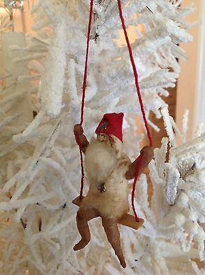 Antique Christmas Paper Face Santa On A Swing