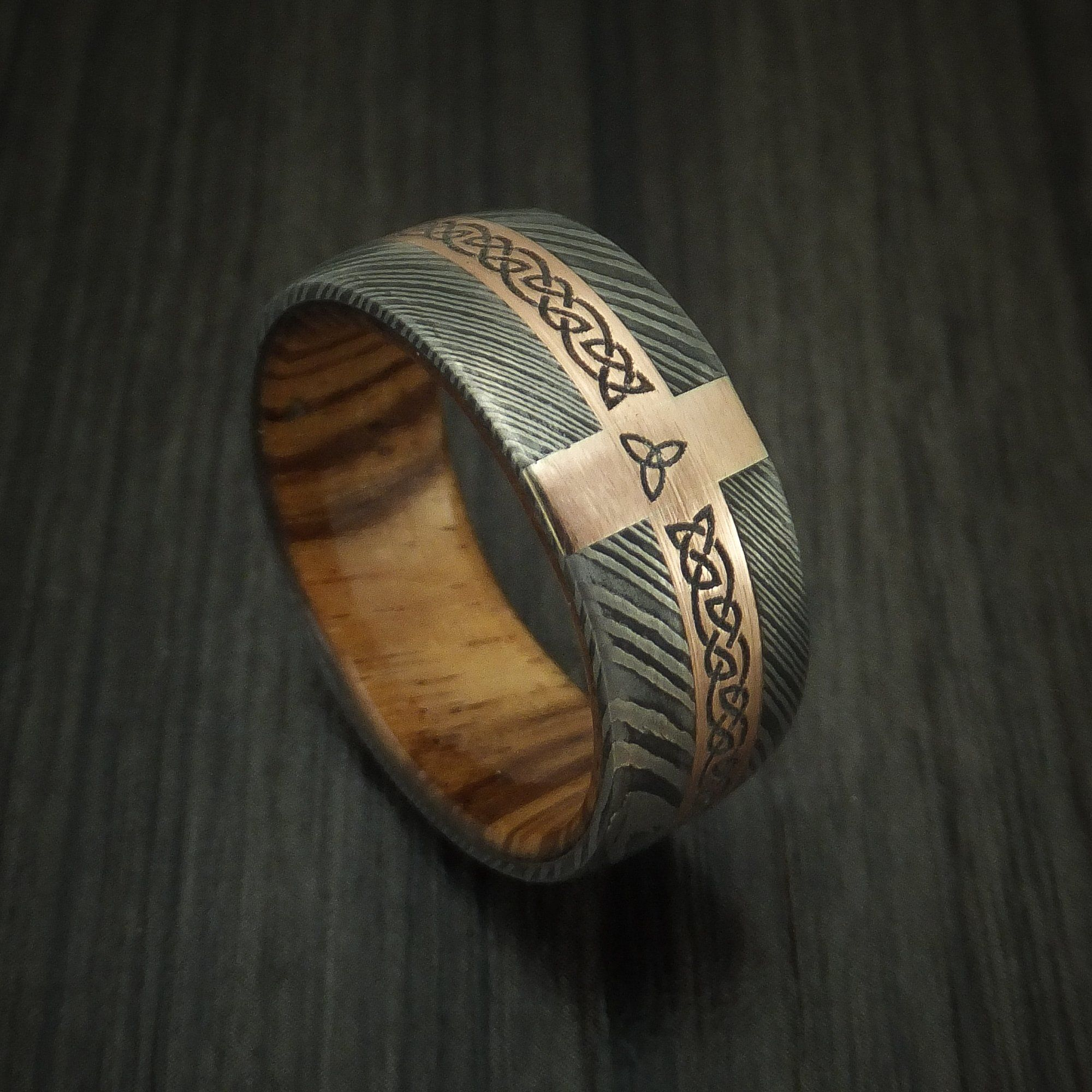 Damascus steel celtic ring with 14k rose gold and hardwood