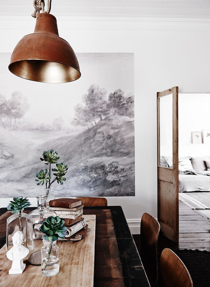 rustic industrial dining room with a wall mural