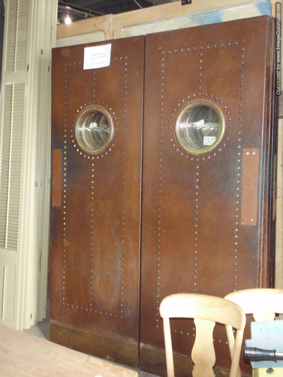 Salvaged courtroom doors as swinging kitchen doors. | Cafe ...