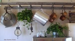 using old ladder for pot rack.  maybe think in front of picture window instead of over fireplace...