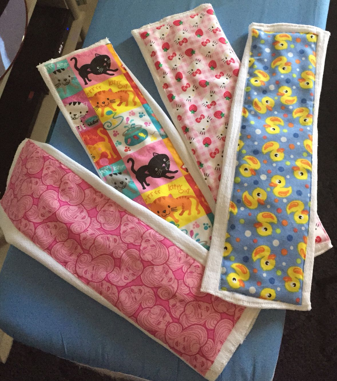 Baby burping cloths, homemade from cotton patterns and cloth diapers.