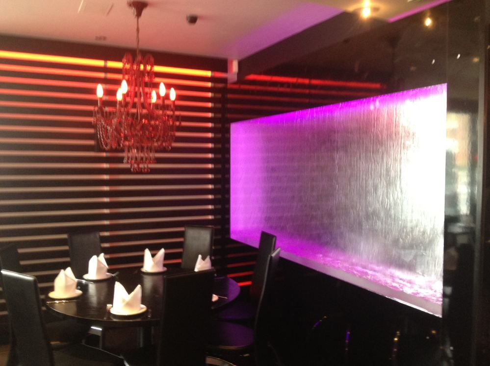 this waterfall panel is an excellent idea for restaurant decor