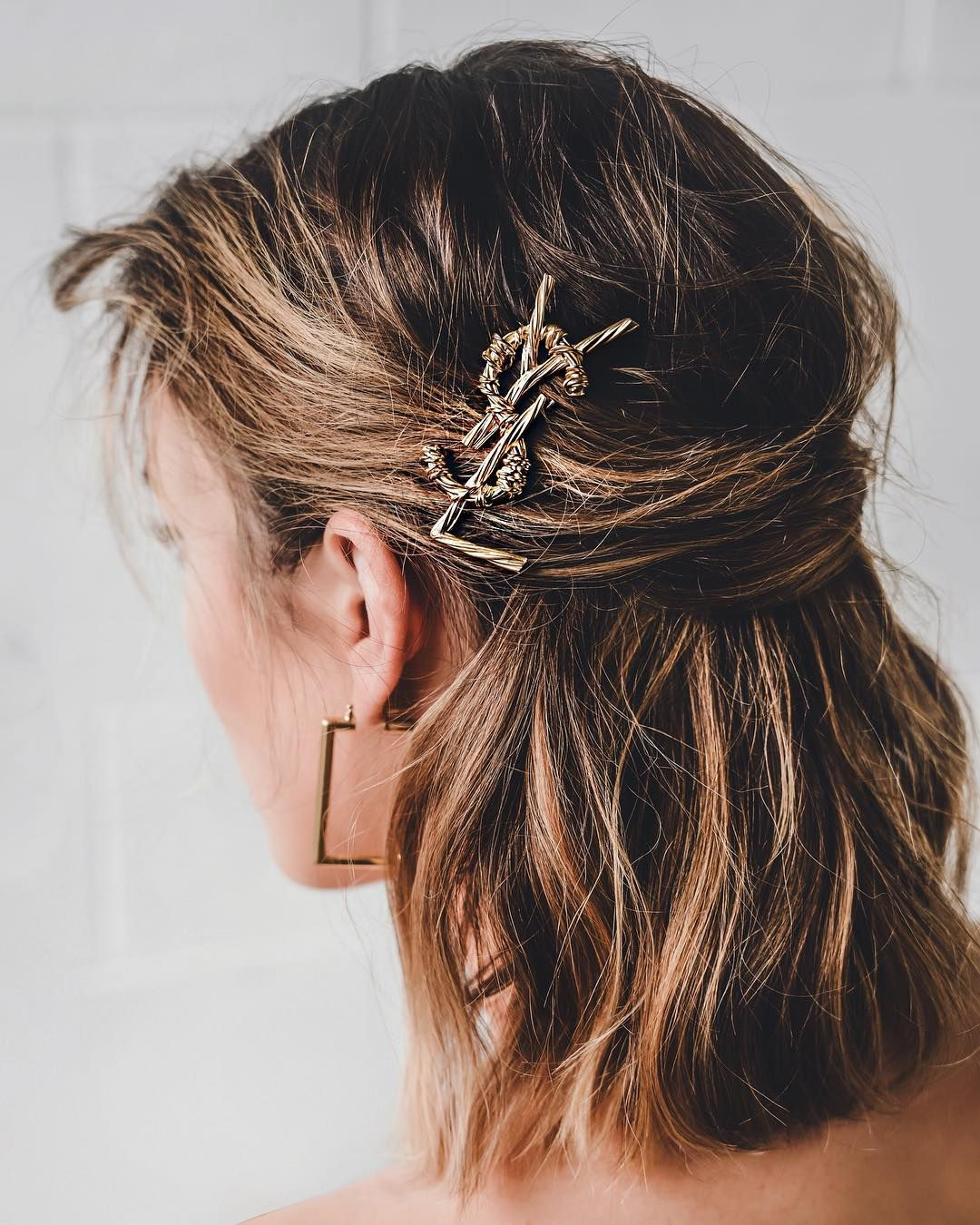 Hair clips are my weakness. YSL hair clips 🖤 @ysl @harroldsaus