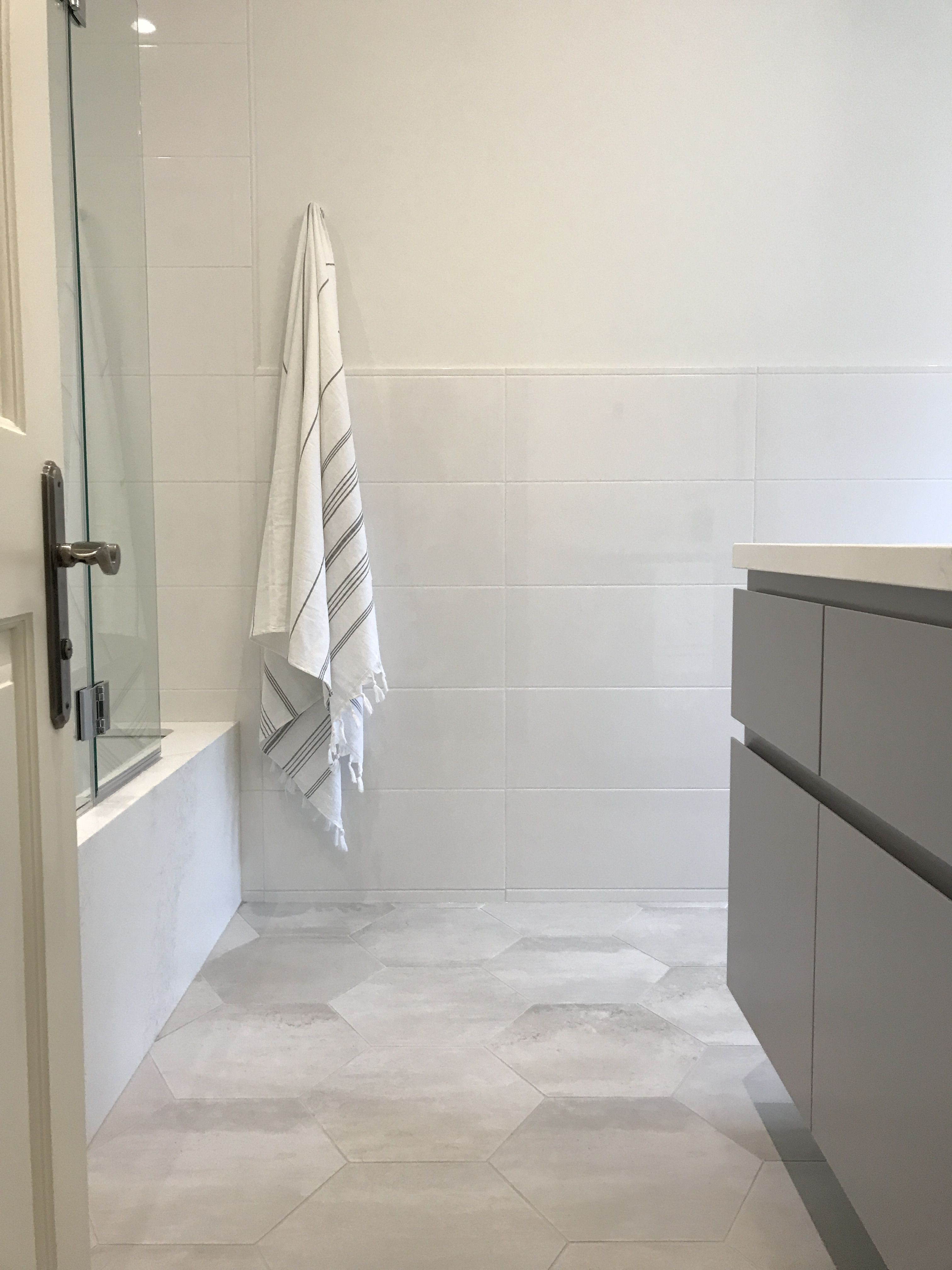 wall faucet, custom vanity, grey, large white subway tile,hexagon ...