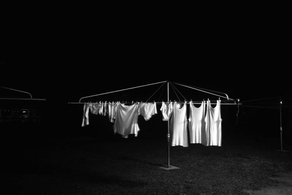 Trent Parke (Australian, b. 1971) AUSTRALIA. Queensland. Washing hangs on the line in a caravan park in outback Queensland. Minutes To Midnight. 2003.