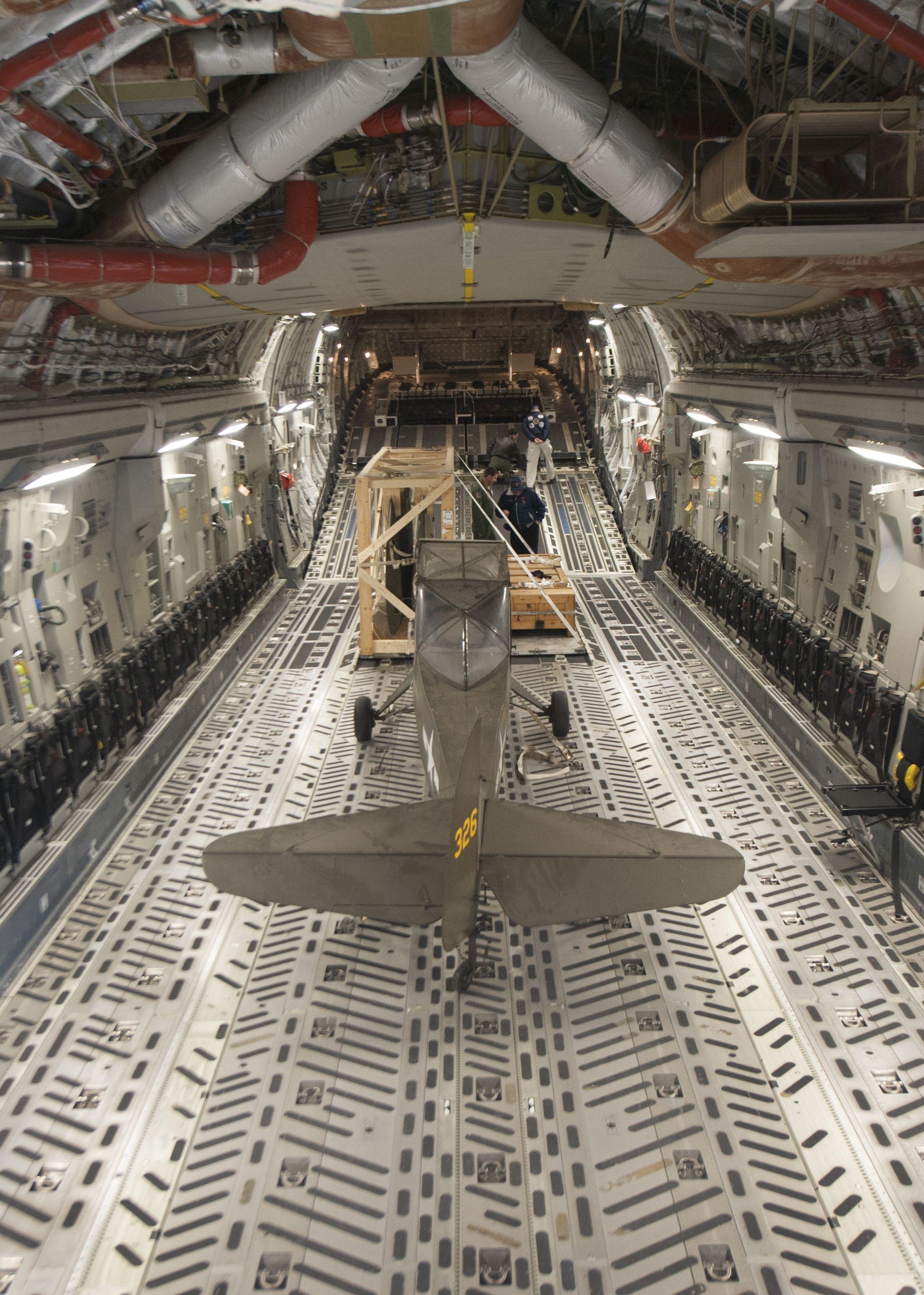 A palletized Taylorcraft L2M sits inside