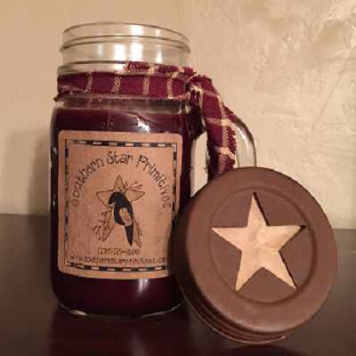 """Southern Star Primitives ~ Our Own Hand Poured """"Pint Size Scented Drinking Jar Candle"""". This candle is scented through out, has a rusty star cut out lid and homespun wrapped around the neck of the jar. Available in the following scents: Apple Cinnamon, Blueberry, Butterscotch, Cinaberry, Cinnamon, Chocolate, Country Clothesline, Cranberry, Orange Spice, Pumpkin Spice, Southern Pine, Spicy Plum Pudding, Sugary Maple Syrup."""