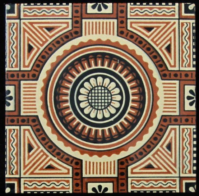 Super, strong design of a central and stylized flower surrounded by intricate geometric design printed in two colors on a heavy, buff clay body from Mintons China Works.