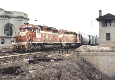 #921 lead unit and one unit with a freight train southbound at the Union Depot going through the crossovers in Joliet, IL on March 19, 1971