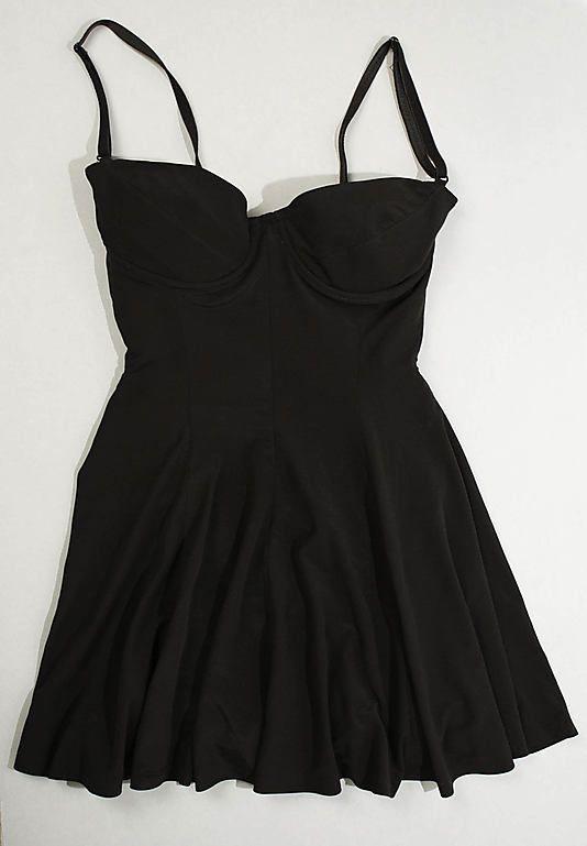 "Bathing Suit, Norma Kamali (American, born 1945): ca. 1990, American, nylon/lycra, polyester.    Marking: [label] ""OMO / Norma / Kamali"""