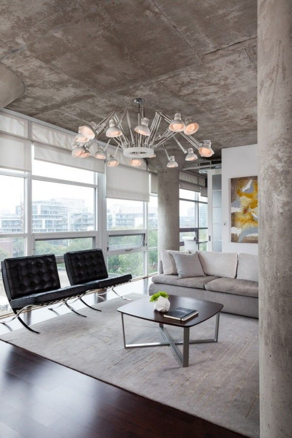 Exposed concrete ceiling and pillars counteract the glossy look of en vogue elements