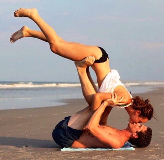 Couples yoga on the beach