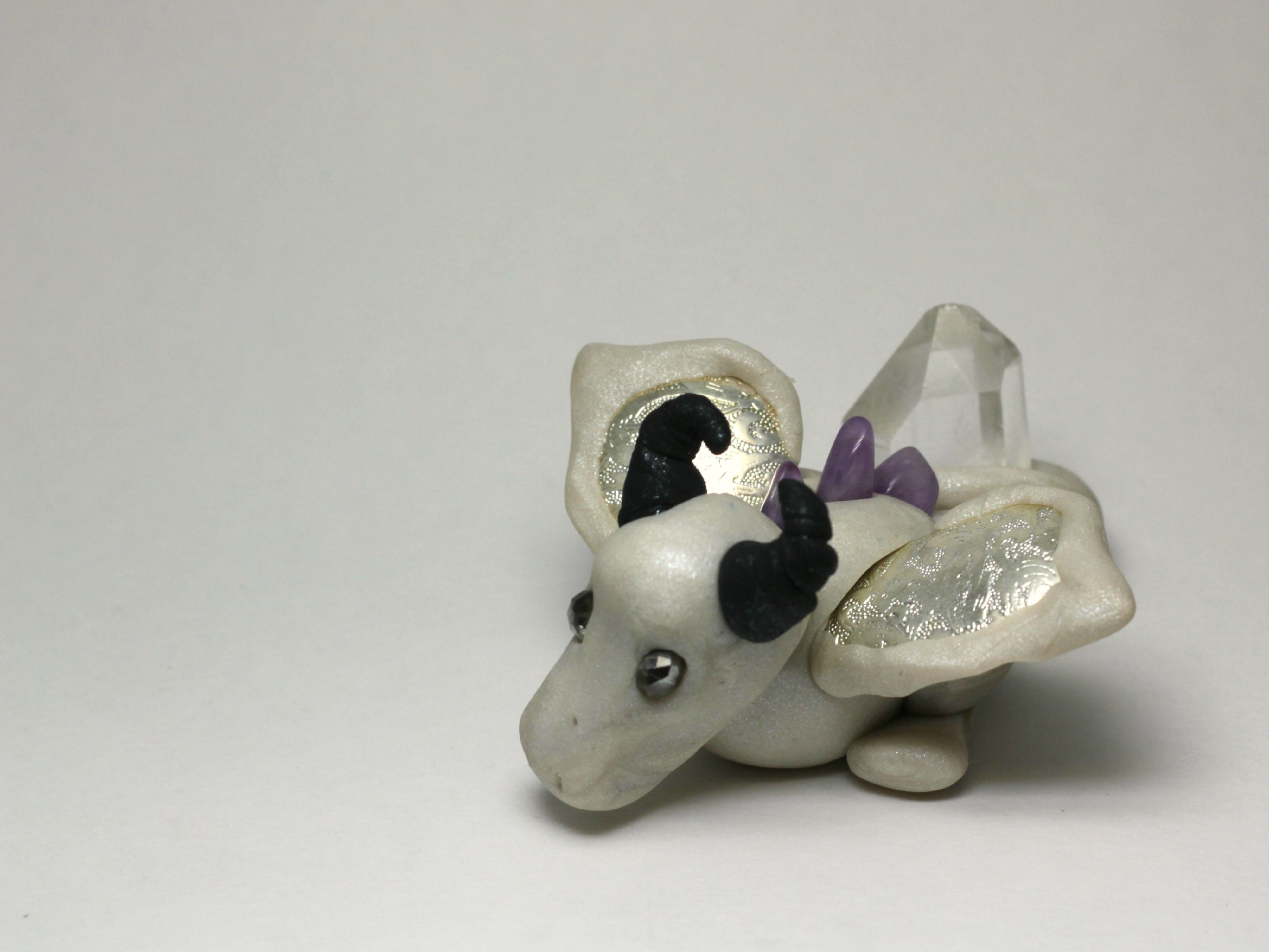 This baby boy is looking for a new home! He shimmers like a pearl and even comes with his own little crystal treasure, tightly wrapped in his tail.   Ready to ship.  Visit my FB page for giveaways etc https://www.facebook.com/RaeosunshinePets