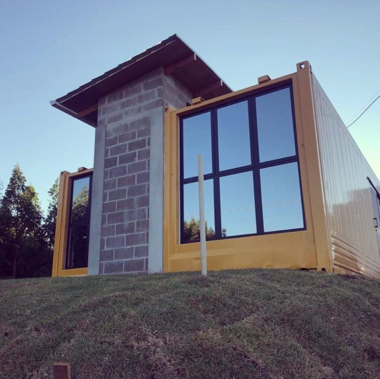 House Made With The Harmony Of Concrete And Shipping Container From Brazil Living In A Container In 2020 House Made Shipping Container House